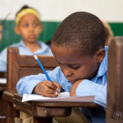 An African youngster studies hard during a children's education program at the St. Andrew's Refugee Services centre in Cairo in 2016
